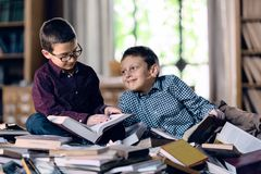 Children with books in the library royalty free stock images
