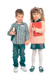 Children with books on a white background. Girl and boy with books holding hands Stock Photo