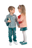 Children with books on a white background. Girl and boy with books holding hands on a white background Stock Images