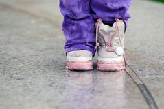 Children boots in the rain Royalty Free Stock Photo