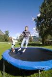 Children bouncing. Stock Images