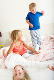 Children Bouncing On Bed. Smiling Royalty Free Stock Image