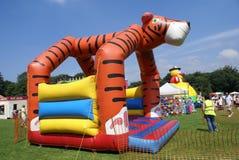 Children bouncy castle in a fete, carnival, festival, or fair Stock Images