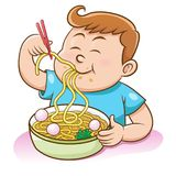 Children Boy Eating Noodles With Chopsticks Royalty Free Stock Photography