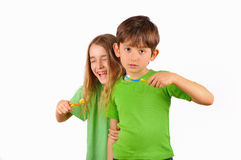 Children, boy and girl brush their teeth and laugh Stock Photos