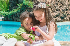 Children boy and girl with flower Royalty Free Stock Images