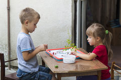 Children boy and girl playing together Stock Photo
