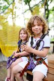 Children - a boy and a girl in the rope park pass obstacles royalty free stock photography