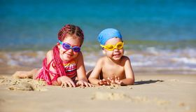 Children boy and girl in swimsuit on beach stock image