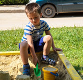 Children boy playing in the sandbox Royalty Free Stock Photography