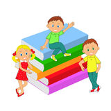Children, boys, girl and a stack of books Stock Images