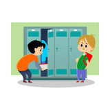 Children boys near lockers in the locker room of the school dress up and put their personal belongings and books for