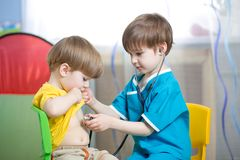 Children boys play doctor Stock Photo