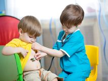 Children boys play doctor. Together at home Stock Photos