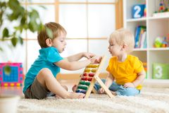 Children boys playing with abacus Royalty Free Stock Photos