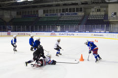Children boys playing hockey on ice in the Yunost' stadium Stock Photography