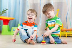 Children boys with toys in playroom Stock Photography