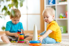 Children boys with toys in playroom Stock Photo