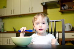 Children breakfast. Little boy eating breakfast in dining room Royalty Free Stock Image