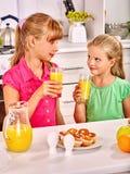 Children   breakfast at kitchen Stock Photo