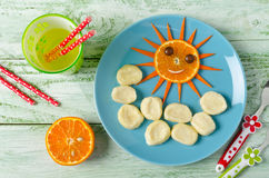 Children breakfast lazy dumplings and orange in the shape of the Stock Photos