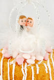 Children bride and groom figurines on a cake Stock Photo