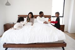 Children Bringing Parents Breakfast In Bed To Celebrate Mothers Day Fathers Day Or Birthday stock images