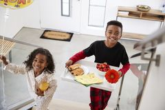 Children Bringing Parents Breakfast In Bed On Tray To Celebrate Birthday Mothers Day Fathers Day royalty free stock images