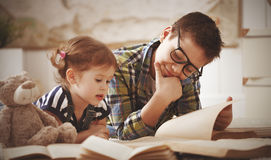 Children brother and sister, boy and girl reading a book Royalty Free Stock Images