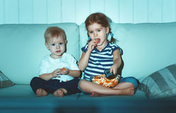 Children brother and sister watching TV in evening. Children brother and sister watching TV in the evening Royalty Free Stock Images