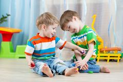 Children brothers playing together in nursery Royalty Free Stock Image