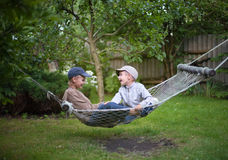 Children brothers talking  country garden outdoor. Selective focus Stock Images