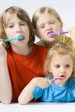Children brushing teeth Stock Photos