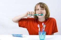 Children brushing teeth. Little girl wearing colorful t-shirts brushing teeth stock image