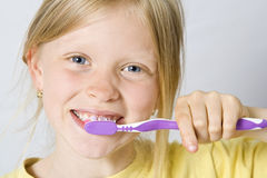 Children brushing teeth Royalty Free Stock Images