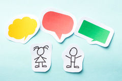 Children with bubbles. Paper children with colorful blank dialog speech bubbles Royalty Free Stock Photos