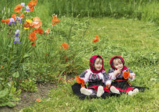 Children of Bucovina. Two twin little girls dressed in a traditional costume from Bucovina, Romania Royalty Free Stock Photo