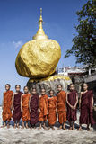Children Buddhas in front of the golden rock, Birmania, Myanmar Stock Photos