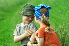 Children with bug. In grass Royalty Free Stock Images