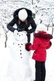 Children build the snowman Stock Image