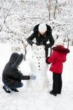 Children build the snowman Stock Photo