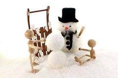 Children build a snowman Royalty Free Stock Images