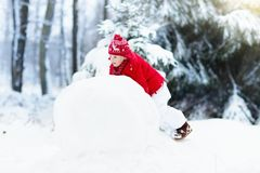 Kids building snowman. Children in snow. Winter fun. Royalty Free Stock Photos