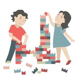 Children build a toy house. Boy and girl are building a toy house Royalty Free Stock Images