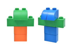 Children building blocks toy stacked as a robot. On white stock photos