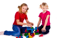 Children building a castle with cubes Stock Photos