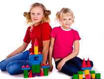 Children building a castle with cubes Stock Photo