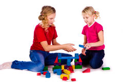 Children building a castle with cubes Stock Image