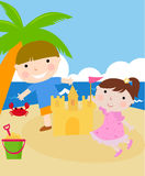 Children building a sand castle Stock Photos