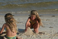 Children building sandcastle. At the beach Royalty Free Stock Image